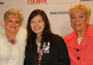 Isabella Leung (c.), Crystal Window & Door Systems' HR Manager, receives Rising Star Award from Queens Courier founder and publisher Vicki Schneps (l.) and Queen Borough President Helen Marshall (r.).