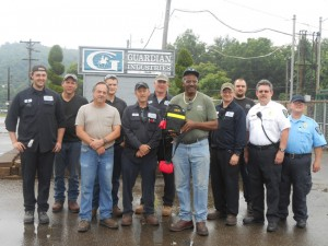 Glenn Caldwell and PEO Team members at the plant