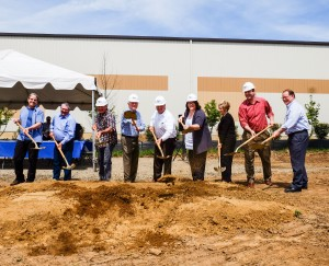 ICD High Performance Coatings employees stand with shovels at the site of the company's new facility in Washington State. (photo provided)