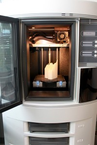 Crystal Windows' 3-D printer, shown with a finished prototype model in place, has been successfully utilized for the past three years.