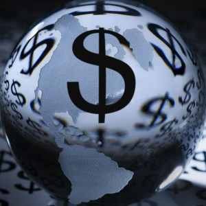 Glass globe with dollar signs on background with money symbol.