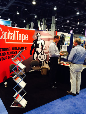 Capital Tape's Mark Swanson shows his company's product Thursday at GlassBuild America in Las Vegas.