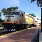 A SunRail train leaving a Florida train station.