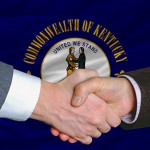 two businessmen shaking hands after good business investment  agreement in front US state flag of kentucky