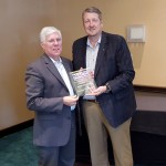 Ajay Glass CEO (right), chairman of the NACC board,, presents a plaque to industry specifier David Stutzman (left), president of Conspectus, Inc. in Tuckahoe, N.J. , recognizing him as a founding member of the certification board.