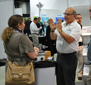 Nicholas Cekine of Halfen explains to an attendee how the company can help achieve sustainability.
