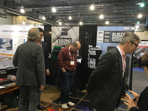Glass industry exhibitors such as ONYX Solar were busy on the show floor Friday.