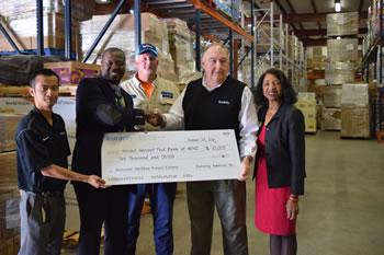 "Jai ""Chow"" He (Kuraray); Ron Pringle, Food Bank director; Cecil Brigman (Kuraray); Ross Crews (plant manager, Kuraray); Cynthia Wilson, CEO Action Pathways."